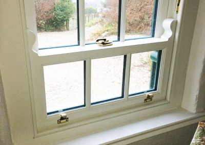 Inside View White Verticle Sliders Timber Windows